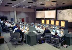 A fully staffed Mission Control Center during the first mission to use it — Gemini IV on June 3, 1965.