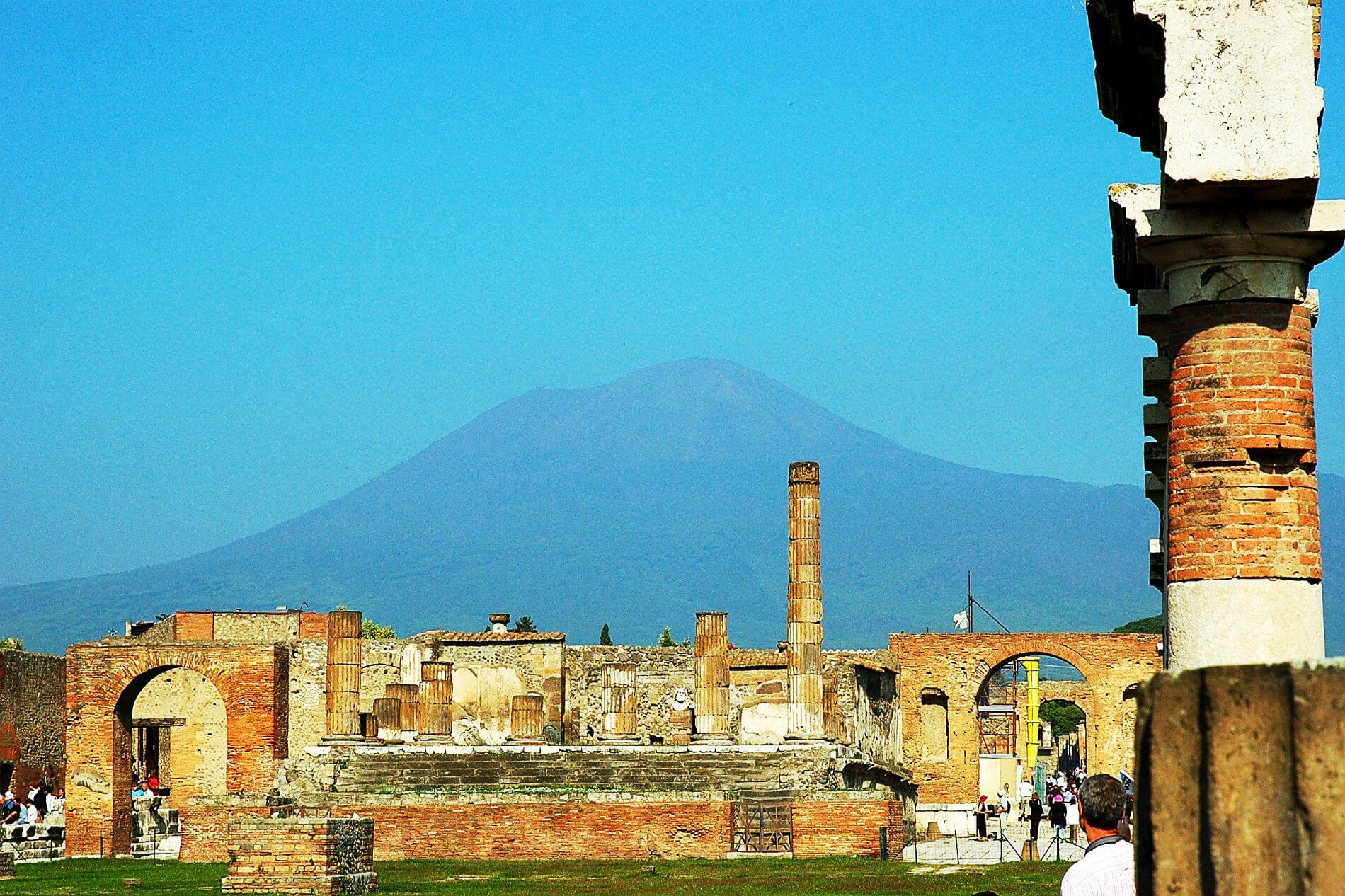 Mount Vesuvius rises in the distance