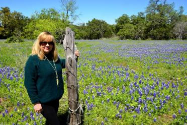 Kathy and field of bluebonnets