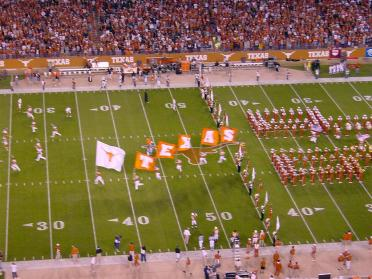 Flags lead the Horns out