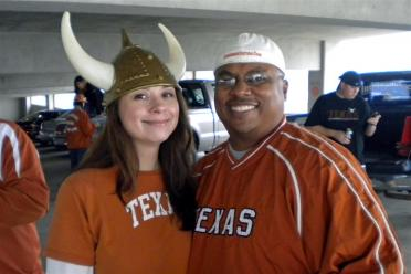 Kelly dons the ritual first tailgate headgear