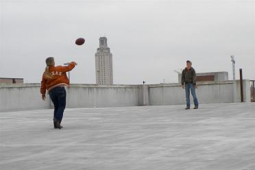 Melanie and Hagen toss a football - pregame tailgate