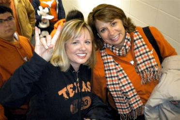 Kathy and Rhonda - on the DKR escalator heading up to our seats