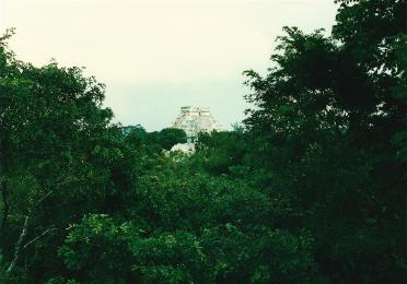 El Castillo rises above the jungle in the distance, as seen from El Caracol